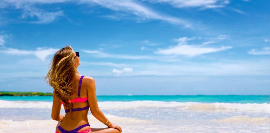 Beautiful woman in bikini on tropical beach
