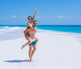 Couple happy together on a vacation on the beach